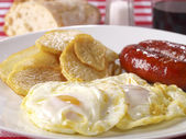 Fried eggs & potatoes with chorizo (red spicy sausage) — Stock Photo