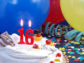 Birthday cake with red candles showing Nr. 16 — Stock Photo