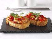 Montadito de Esgarraet – Red pepper and cod on Bread — Stock Photo