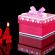 Birthday-anniversary gift with red candles showing Nr. 24 - Stock Photo