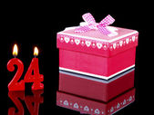 Birthday-anniversary gift with red candles showing Nr. 24 — Stock Photo