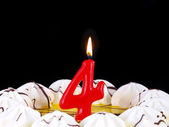 Birthday cake with red candles showing Nr. 4 — Stock Photo