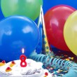 Stock Photo: Birthday cake with red candles showing Nr. 8