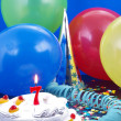 Stock Photo: Birthday cake with red candles showing Nr. 7