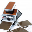 Vintage instant camera with some printed copies. - Stock Photo