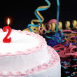 Birthday cake with red candles showing Nr. 2 — Stock Photo