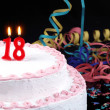 Stock Photo: Birthday cake with red candles showing Nr. 18