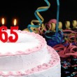 Stock Photo: Birthday cake with red candles showing Nr. 65