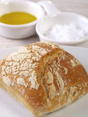 Bread, olive oil, and salt flakes. — Stock Photo