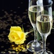 Yellow rose and champagne for a seduction evening. — Stock Photo