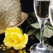 Stock Photo: Yellow rose and champagne for seduction evening.