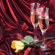 Stock Photo: Yellow rose and champagne for a seduction evening.