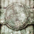 Metal plate on ornate wooden wall — 图库照片