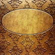 Gold metal plate with ornament  — Stock Photo