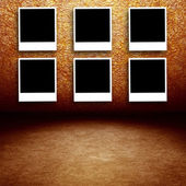 Photo frames on grunge wall — Stock Photo