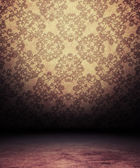 Old empty room with antique pattern on wall — Stock Photo