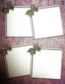 Paper blank with bow in corner on grunge background — Stock Photo