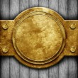 Metal ornate frame on wooden wall — Stock Photo #34081681