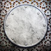 Metal ornament on wooden wall — Stockfoto