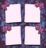 Paper blanks with bow in corner on velvet fabric — Stock Photo
