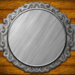 Metal ornate frame on wooden wall — Stock Photo #37789301
