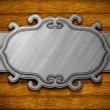 Metal ornate frame on wooden wall — Stock Photo