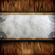 Metal plate on wooden planks — Stock Photo #37789331