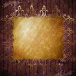 Old gold ornamental frame on wooden wall — Stok fotoğraf