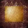Old gold ornamental frame on wooden wall — Stockfoto