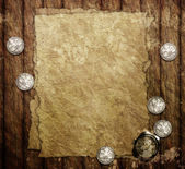 Old paper, clock and silver coins on wooden table — Stock Photo
