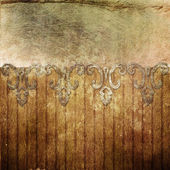 Old gold ornament on wooden wall — Stock Photo