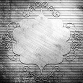 Metal plate on silver background — Stock Photo