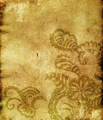 Paisley ornament on empty paper sheet (grunge background) — Stock Photo