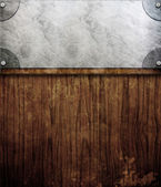 Metal plate on wooden planks — Stock Photo