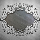 Metal plate with ornate frame — Стоковое фото