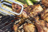 Golden Grilled Wings On Charcoal Grill Being Flipped With Tongs — Stock Photo