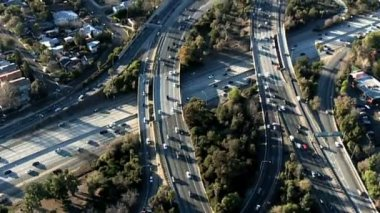 Aerial footage of Los Angeles freeways and suburbs. — Stock Video