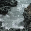 Waves on Lava Rocks - Stock Photo