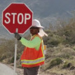 Construction Worker with stop sign - Stock Photo