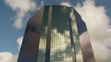 Time Lapse of Reflection of Clouds off a Building — Stock Video