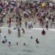 Time Lapse of Crowded Beach - Stock Photo