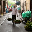 Street Vender In Vietnam - Stock Photo