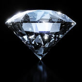 Shiny diamond isolated on black background — Stock Photo