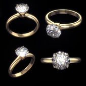 Set of golden diamond rings with clipping path — Stock Photo