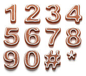 Gingerbread numbers isolated with clipping path — Stock Photo