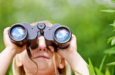 Little girl with binocular — Stock Photo