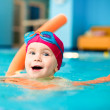 Stock Photo: Child in a swimming pool