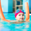 Child in a swimming pool — Stock Photo