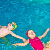 Children in a swimming pool — Stock Photo