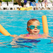 Child in a swimming pool — Stock Photo #13572925